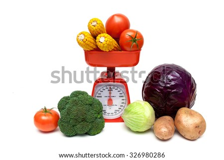 kitchen scales and fresh vegetables isolated on white background. horizontal photo. - stock photo