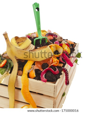 kitchen scraps in compost soil pile wooden crate box isolated on white background  - stock photo