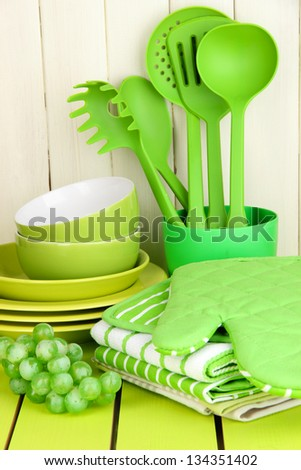 Kitchen settings: utensil, potholders, towels and else  on wooden table - stock photo