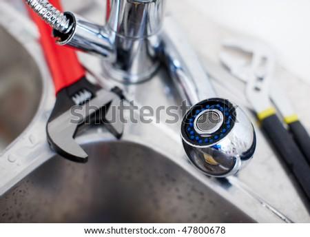 Kitchen sink.  Adjustable wrench. Plumbing. Plumber tool - stock photo