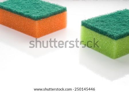 Kitchen sponges isolated on white background - stock photo
