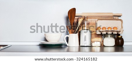 Kitchen Still life as background for Design. Rustic Crockery, Table ware, Fresh Grocery and other Different Stuff on Grey Table-top. Image with copy space - stock photo