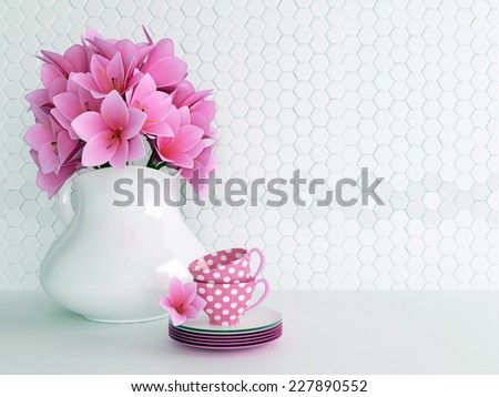 Kitchen still life. Ceramic vase with pink flowers and tea cups on the table. - stock photo