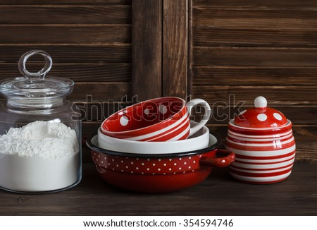 Kitchen still life. Glass jar with flour and vintage crockery -  mug, bowl, jar and pan - stock photo