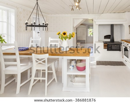 kitchen table by the window in a country-house - stock photo