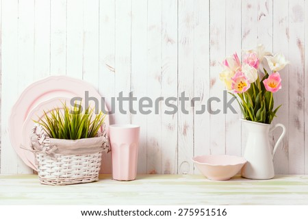 Kitchen table top in rustic shabby chic style, pink decorations - stock photo