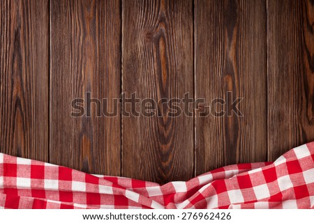 Kitchen table with red towel. Top view with copy space - stock photo