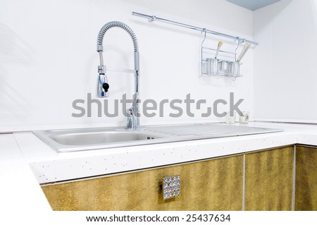 Kitchen tap, indoors shot - stock photo