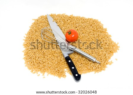 Kitchen tools and pasta on a white background. - stock photo