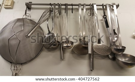 Kitchen tools on a hanger. - stock photo