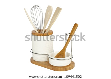 Kitchen Tools, wooden cutlery in ceramic pot - stock photo