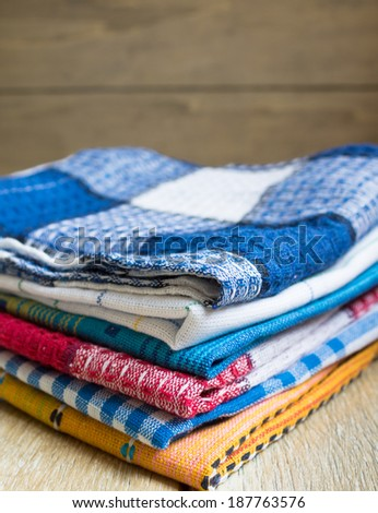 Kitchen towels on the wooden background - stock photo