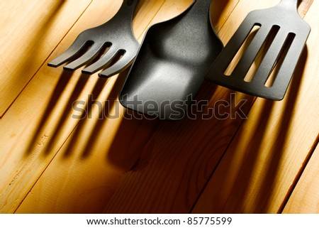 Kitchen utensil collection isolated on wooden background - stock photo
