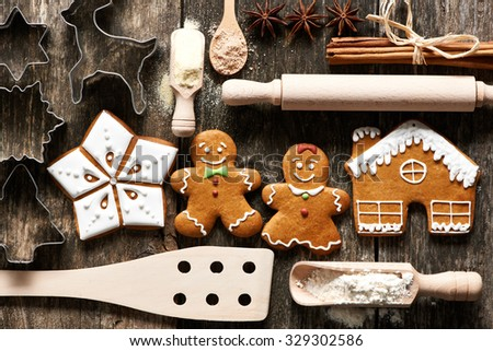 Kitchen utensils and ingredients for christmas homemade gingerbread cookies on wooden table - stock photo
