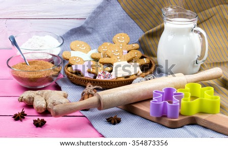 Kitchen utensils and ingredients for christmas homemade gingerbread cookies on wooden table. Anise, cinnamon, baking roll, forms and decoration utensils. - stock photo