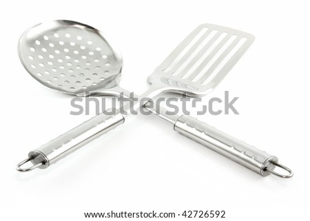 Kitchen Utensils (Colander and Spatula) Isolated on White Background - stock photo