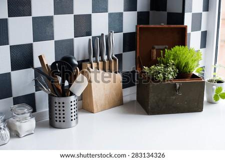 Kitchen utensils, decor and kitchenware in the modern kitchen interior close-up - stock photo