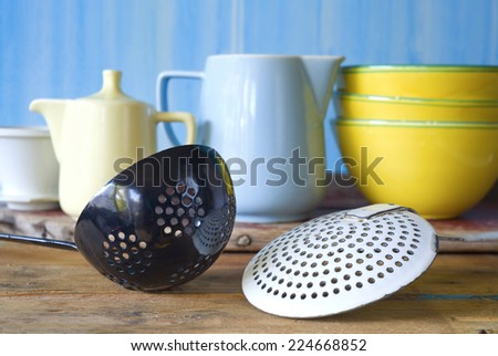 kitchen utensils, dippers and dishes, selective focus - stock photo
