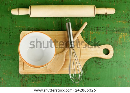 Kitchen utensils for baking on color wooden background - stock photo