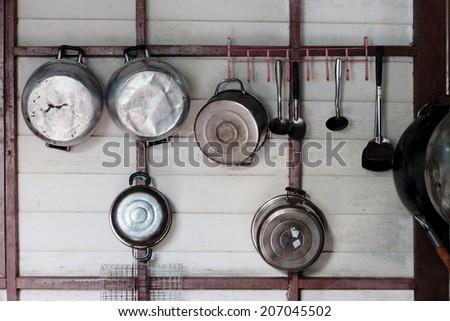 Kitchen utensils hanging  - stock photo