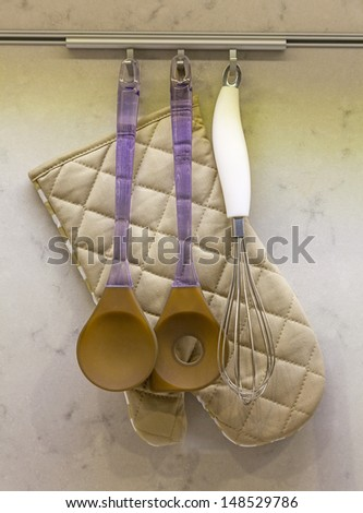 kitchen utensils hanging on the wall