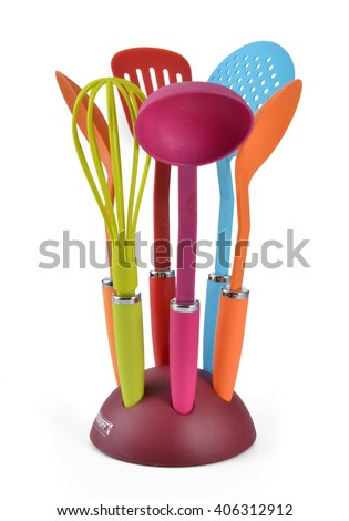 Kitchen utensils in a utensil holder isolated against a white background - stock photo
