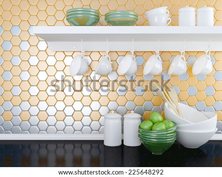 Kitchen utensils on the black worktop. Ceramic and glass kitchenware on the shelf in front of modern orange wall tile. - stock photo