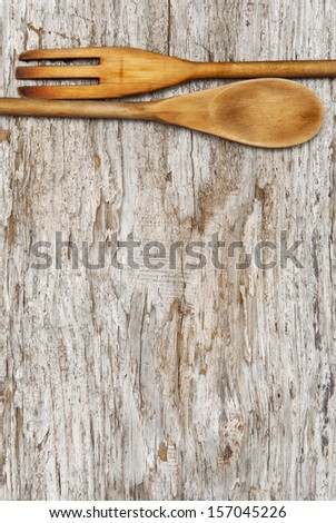 Kitchen utensils on the old wood background - stock photo