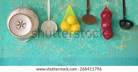 kitchen utensils, onions, lemons, cooking concept - stock photo