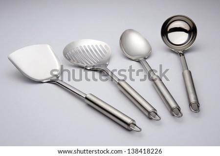 kitchen utensils with plain background, studio shot - stock photo