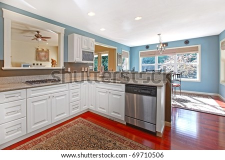 Kitchen white with cherry floor and blue walls - stock photo