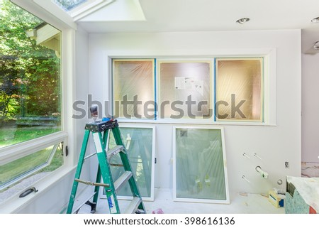 Kitchen window masked for painting - stock photo