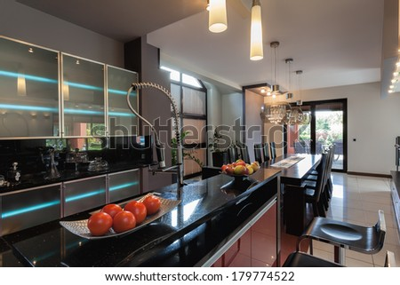 Kitchen with bar counter and long table - stock photo