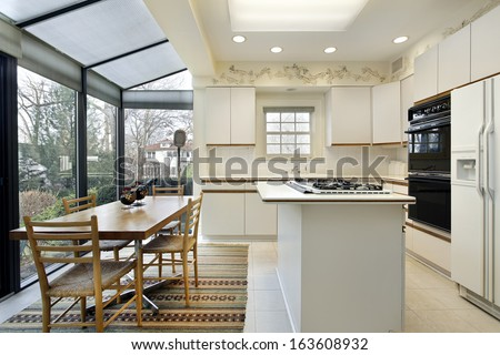 Kitchen with island and sliding doors to patio - stock photo