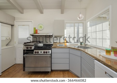 Kitchen with stainless steel gas stove and beautiful yellow river Granite Countertops. - stock photo