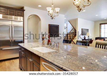 Kitchen with view looking over center island into great room - stock photo