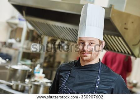 Kitchen worker. Chef cook portrait in restaurant during food preparation. - stock photo