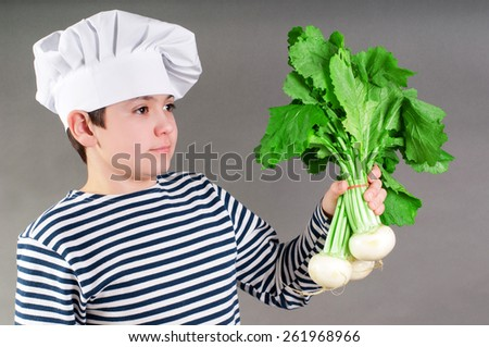 Kitchener with white radish - stock photo