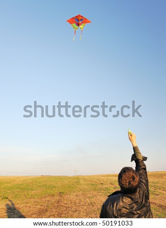 Kite. A colourful kite flying to the dark blue sky - stock photo