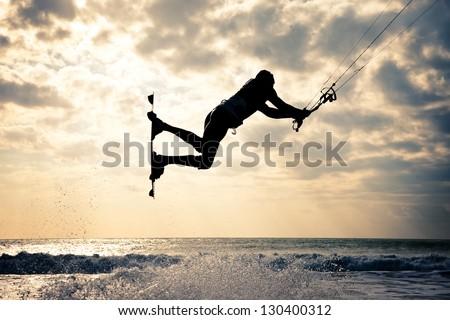 KITE BOARDING. Kite surfer jumping. - stock photo