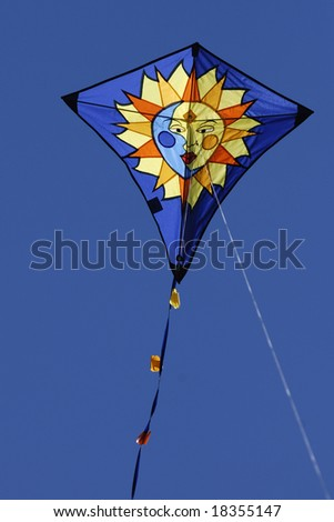 Kite flying on a summer day - stock photo