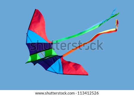Kite in clear blue sky - stock photo