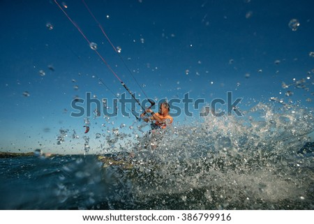 Kite surf freestyle at sunset. - stock photo