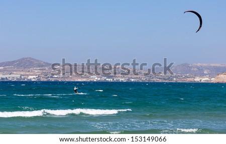 Kite surfer in windy sea - stock photo