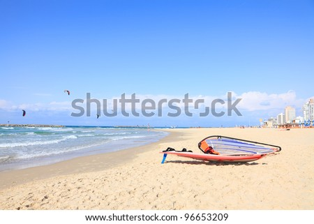 Kite-surfing on Mediterranean coast and view of Tel-Aviv beach. Israel - stock photo