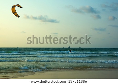 kite surfing on the mediterranean coast, ashdod, israel. - stock photo