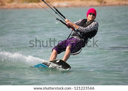 Kiteboarder enjoy surfing - stock photo