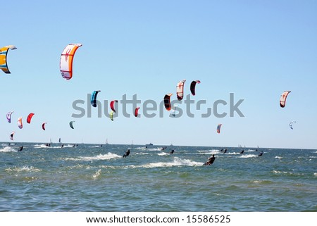 Kiteboarding competition, many kites in the sky