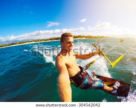Kiteboarding. Fun in the ocean, Extreme Sport Kitesurfing. POV Angle with Action Camera  - stock photo