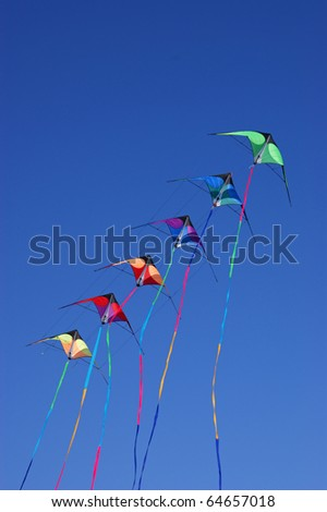 Kites against a vivid blue sky